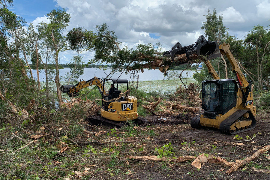 southern environmental cat equipment at work by water